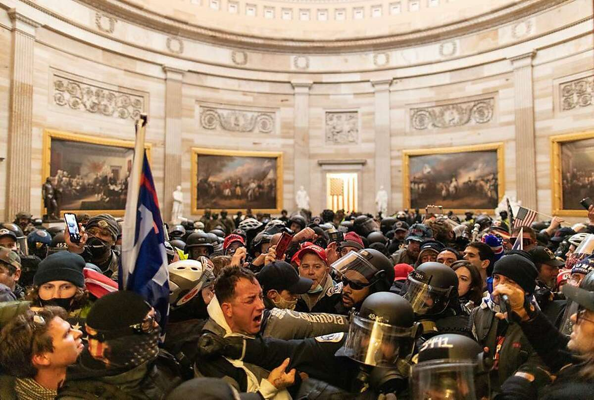 WASHINGTON D.C., USA - JANUARY 6: Police intervenes in US President Donald Trumps supporters who breached security and entered the Capitol building in Washington D.C., United States on January 06, 2021. Pro-Trump rioters stormed the US Capitol as lawmakers were set to sign off Wednesday on President-elect Joe Biden's electoral victory in what was supposed to be a routine process headed to Inauguration Day. (Photo by Mostafa Bassim/Anadolu Agency via Getty Images)