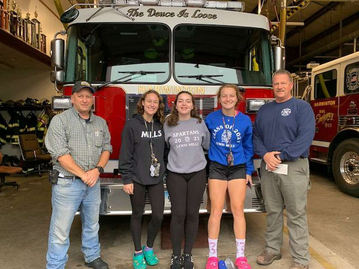 The Lewis S. Mills volleyball team held their annual Car Wash and, rather than keep the funds for the team, they donated $1,267.00 to the Harwinton Volunteer Fire Department to support the department with all they do for our community. The team held a second car wash in lieu of the annual Dig Pink Fundraiser. The second car wash raised funds for the Charlotte Hungerford Hospital's Pink Rose Foundation. The team raised $1,008.00 for the Foundation.