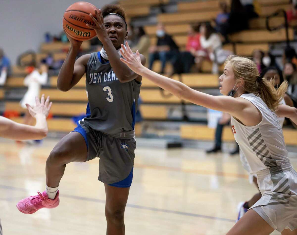 New Caney power forward Mickayla Leftridge (3), shown here last month against Grand Oaks, scored a game-high 22 points Friday night at Caney Creek.
