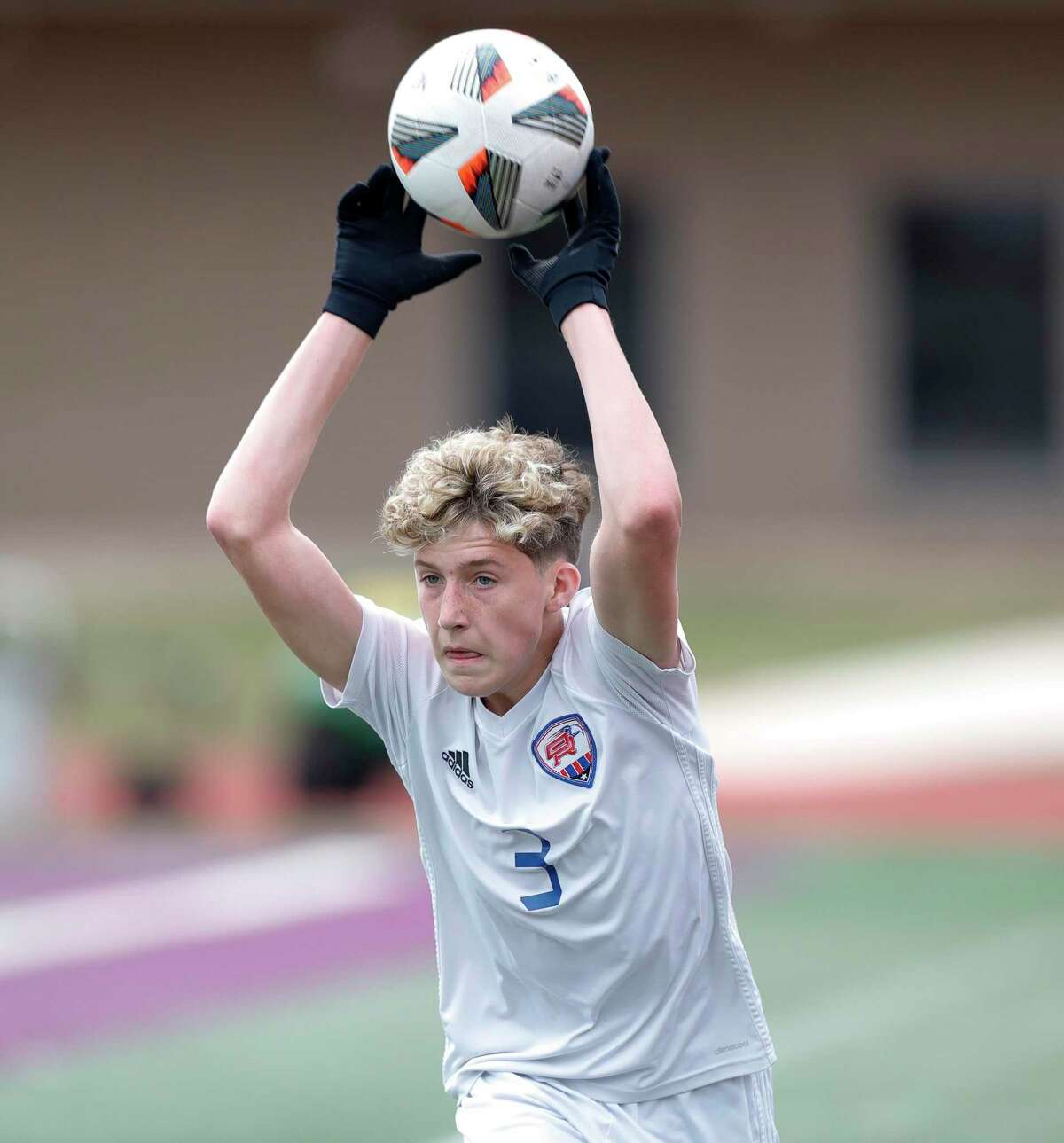 Oak Ridge's Jacob Webb (3) throws the ball in bounds in the first period of a match during the Wildkat Showcase soccer tournament at Berton A. Yates Stadium, Friday, Jan. 8, 2021, in Willis.