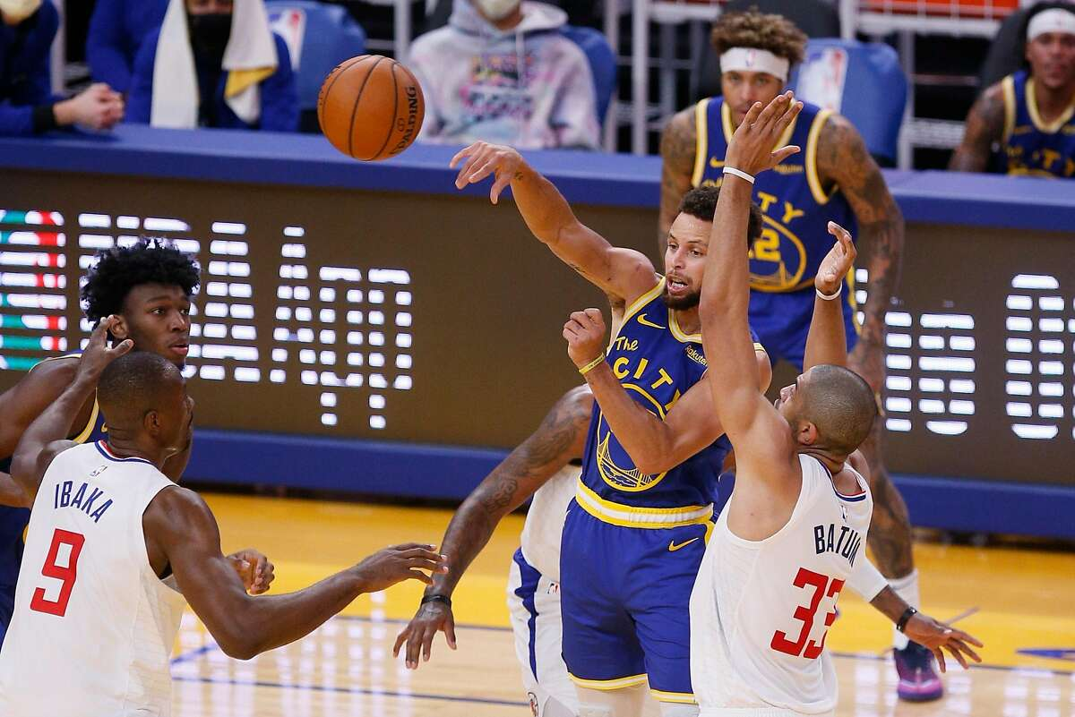 Golden State Warriors guard Stephen Curry (30) turns the ball over in the second quarter during an NBA game against the LA Clippers at Chase Center, Friday, Jan. 8, 2021, in San Francisco, Calif.
