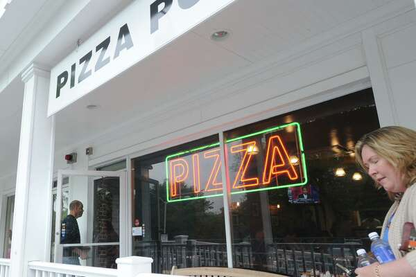 The Pizza Post located at 522 E. Putnam Ave., in the Cos Cob section of Greenwich, Conn., Thursday, May 22, 2014, will reopen soon.