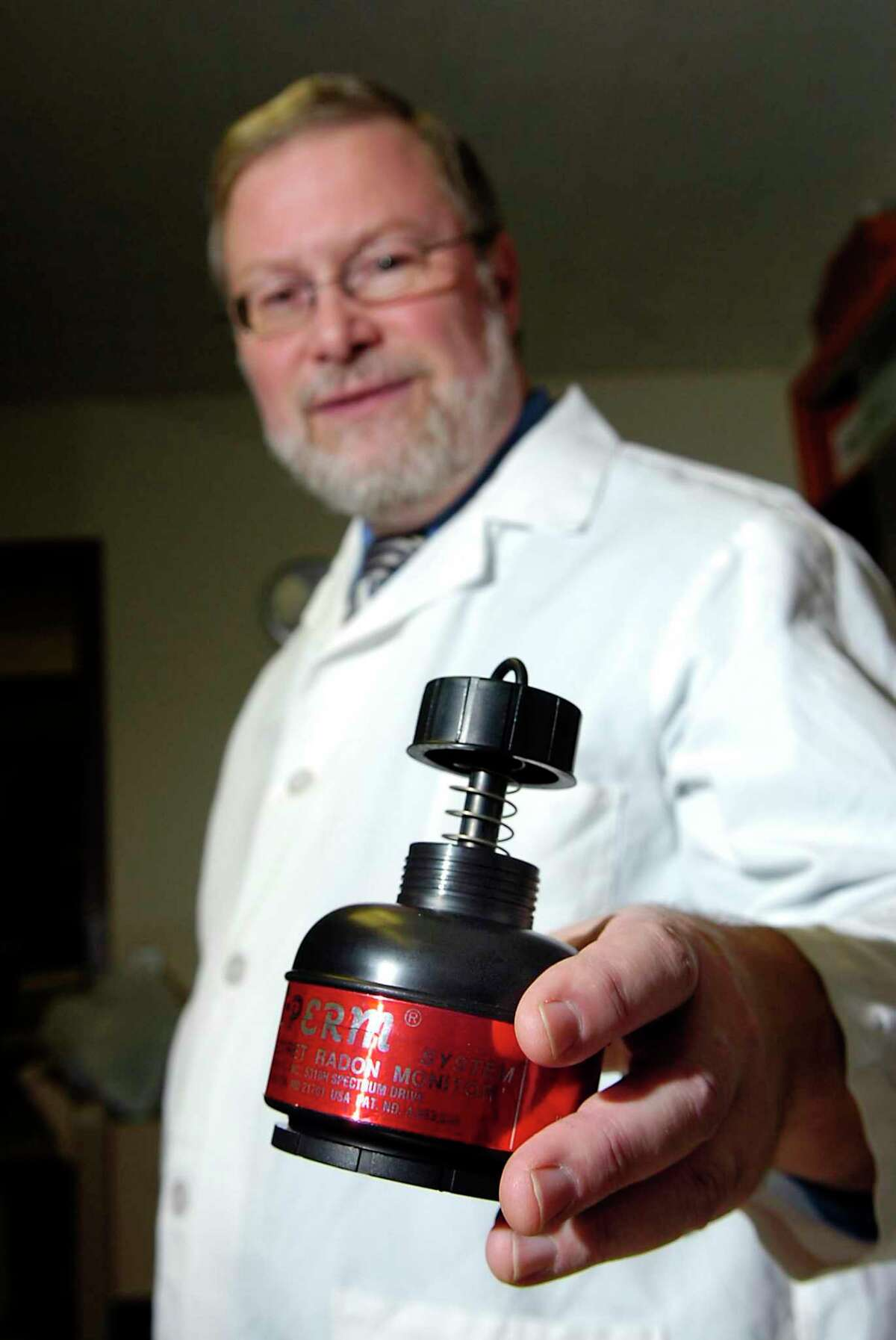 Doug Serafin, of the Greenwich health department lab, poses with a the radon testing kit. The kits are being made offered at a discount through January.