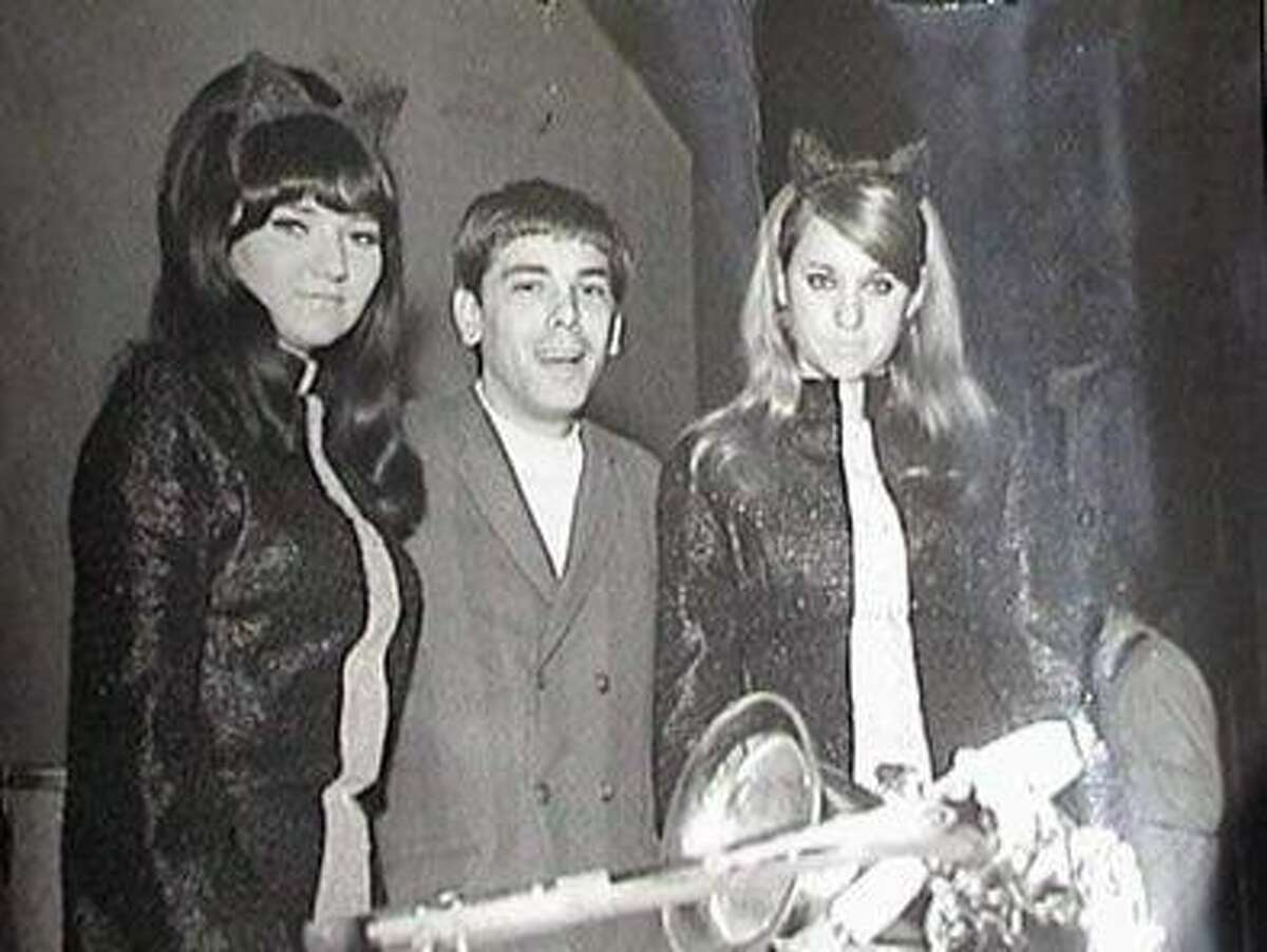 Hostess Linda Cotton, DJ Gary Allyn and hostess Susan Velzy get ready to present an award at the Pusi-Kat Club in downtown San Antonio in 1967. The popular club often held