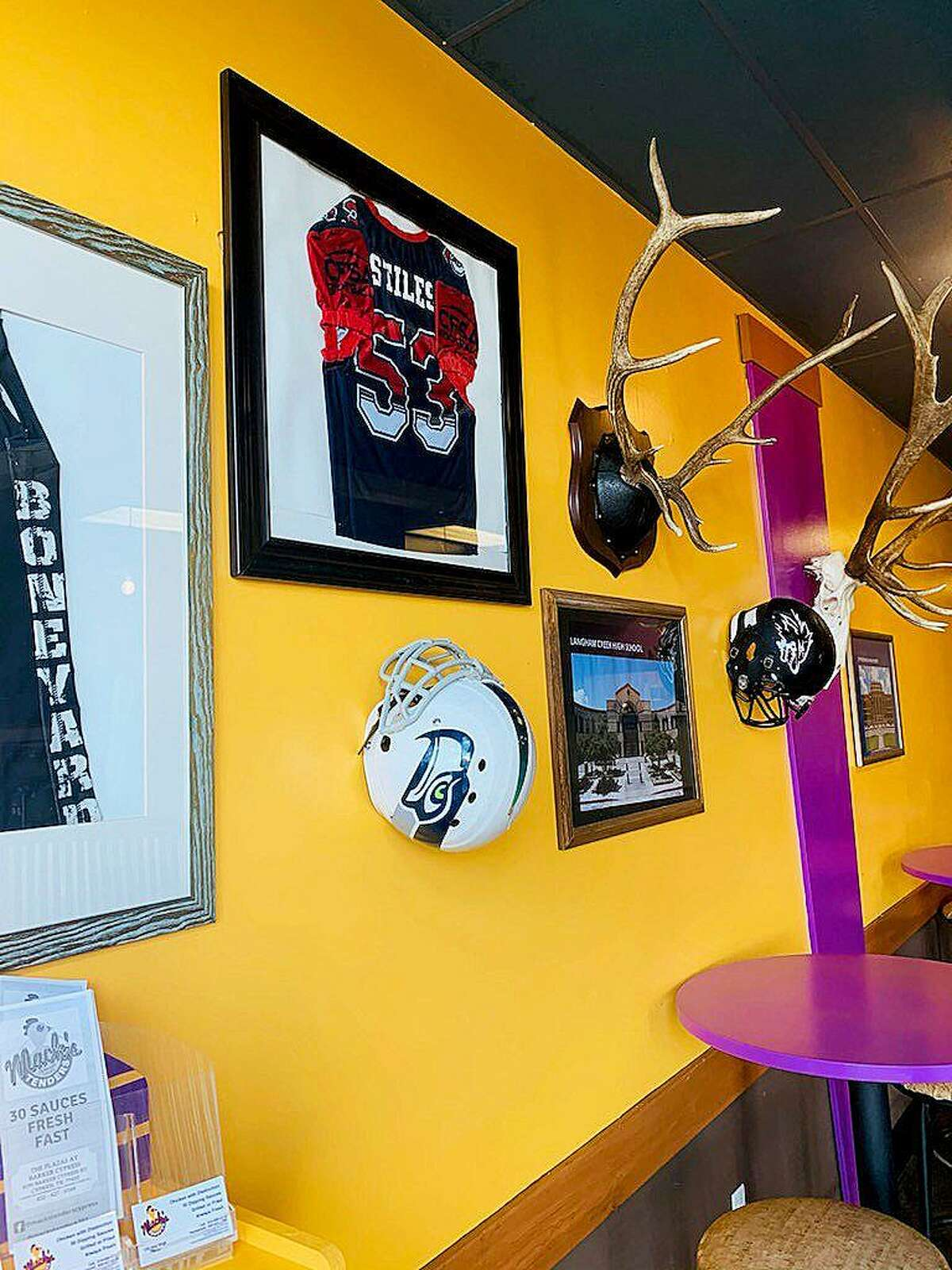Wall art at Mack's Tenders in Cypress. The restaurant received a reprieve on Christmas Day in the form of a donation from Bar Stool Sports founder David Portnoy.