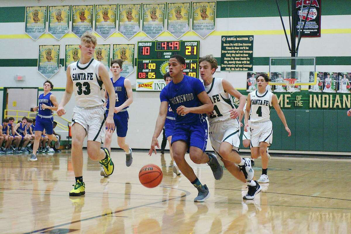 Friendswood's Troy Barnes (3) dribbles down the court past Santa Fe's Ivan Lloyd (21) Friday at Santa Fe High School.