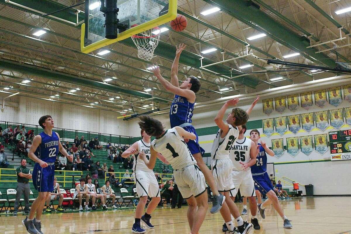 Friendswood's Travis Gibbons (13) puts up a shot over Christian Schanzer (1) of Santa Fe Friday at Santa Fe High School.