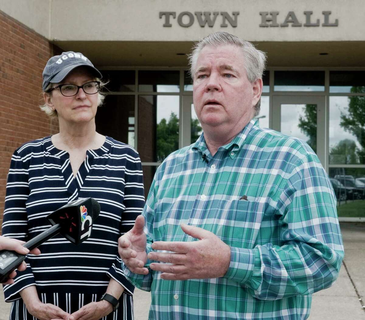 Brookfield Selectman Sue Slater listens to First Selectman Stephen Dunn Brookfield at Town Hall in May 2018, discuss the storm damage to the town.