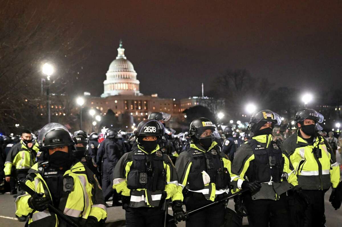 Police clear the area around the U.S. Capitol on Wednesday after pro-Trump supporters swarmed the building in an effort to prevent Congress meeting in joint session to confirm Joe Biden's presidential win.