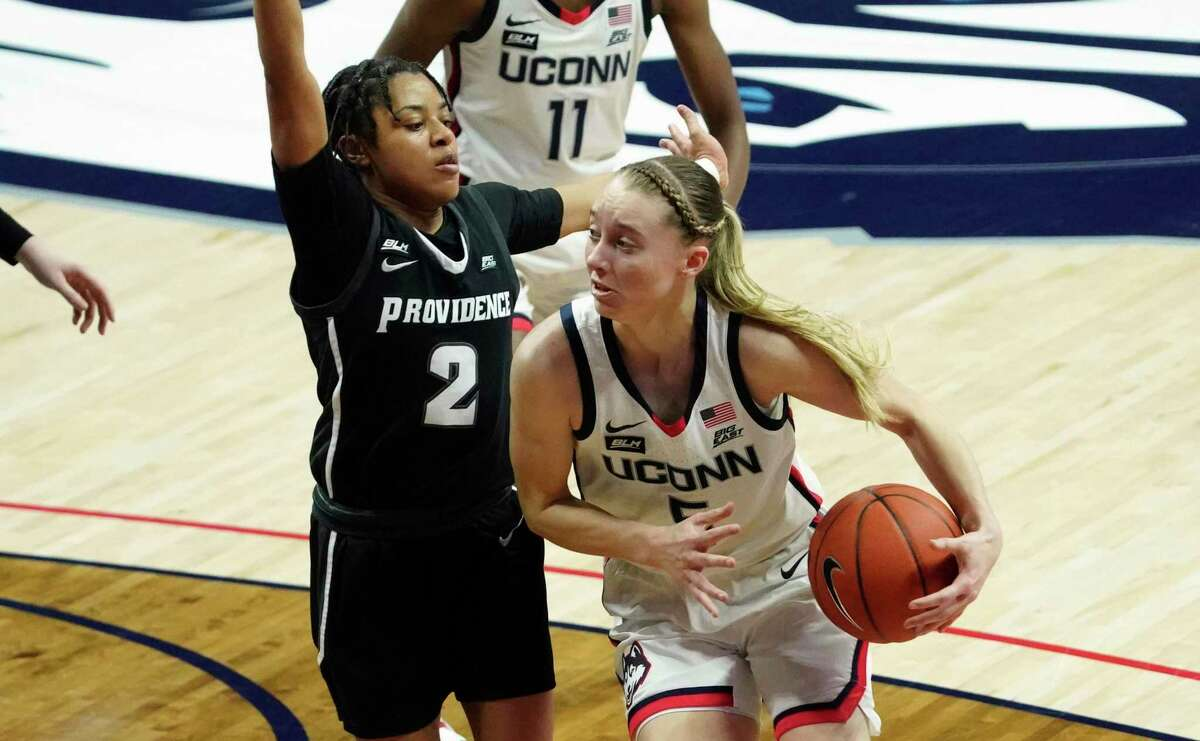 UConn's Paige Bueckers, right, drives against Providence guard Chanell Williams during the first half on Saturday.