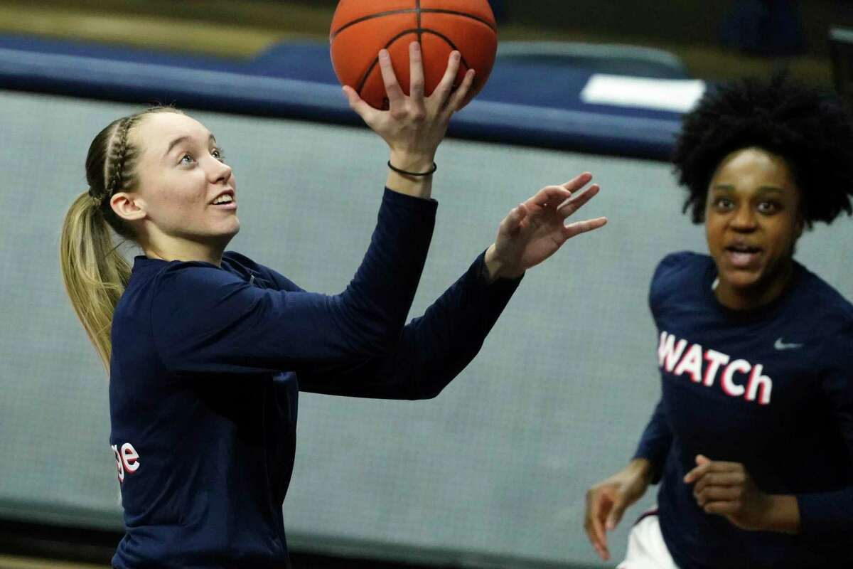 UConn's Paige Bueckers, left, and Christyn Williams warm up before Saturday's game against Providence in Storrs.