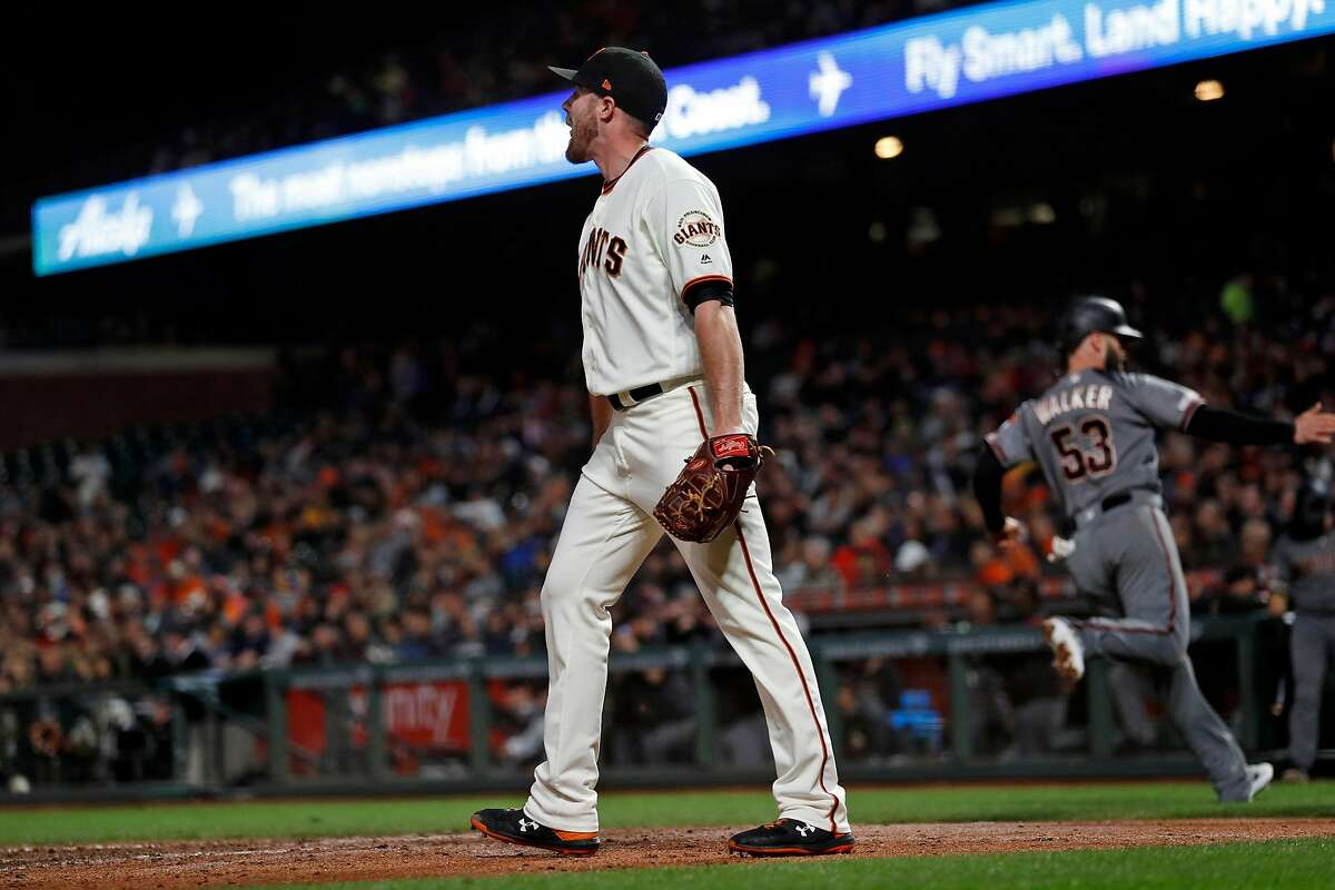 San Francisco Giants' Sam Coonrod reacts as Arizona Diamondbacks' Christian Walker scores on a 6th inning single by Adam Jones in MLB game at Oracle Park in San Francisco, Calif., on Tuesday, August 27, 2019.