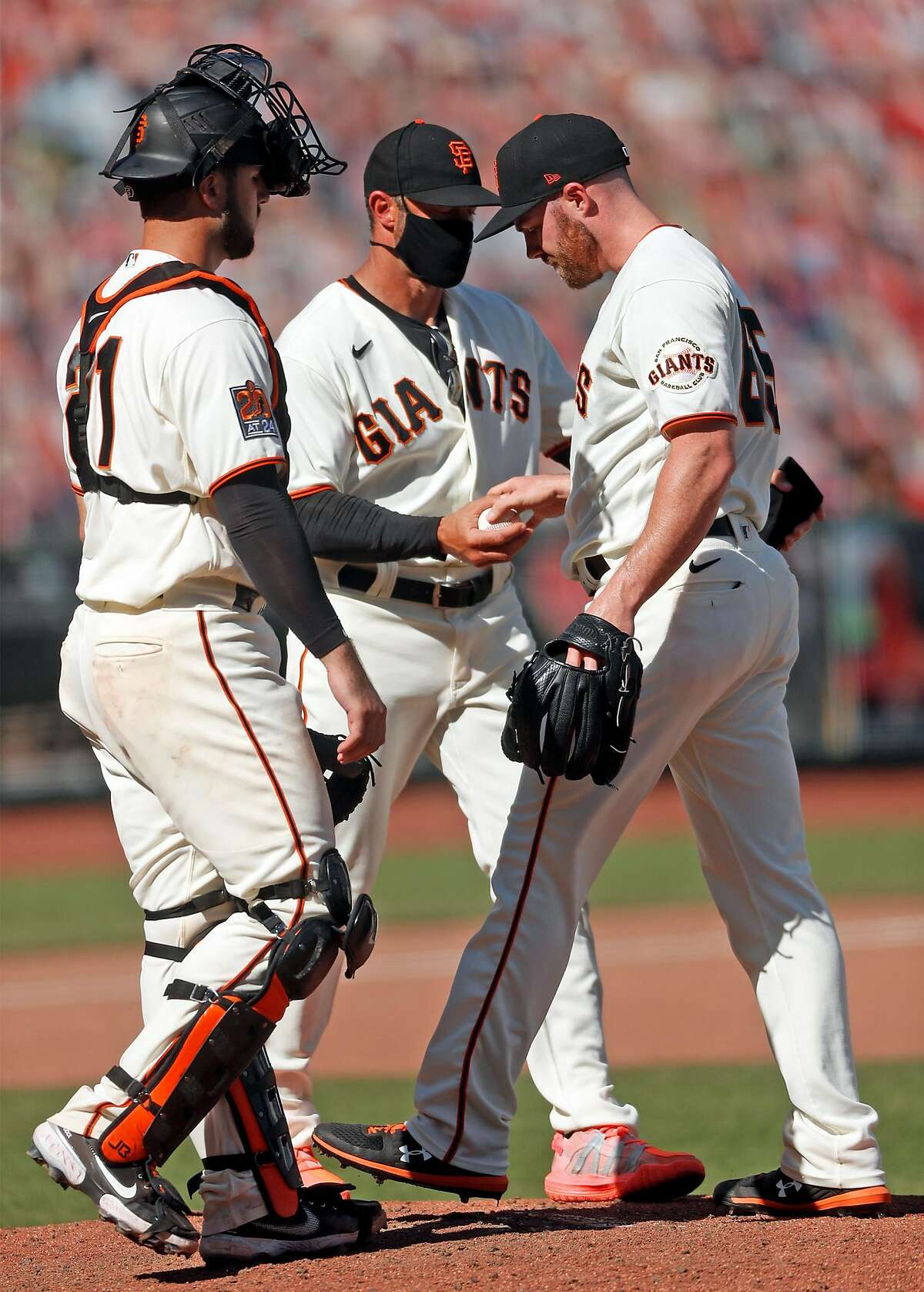 San Francisco Giants' manager Gabe Kapler removes Sam Coonrod after the reliever gave up the tying and go-ahead runs to Colorado Rockies in 7th inning during MLB game at Oracle Park in San Francisco, Calif., on Thursday, September 24, 2020.