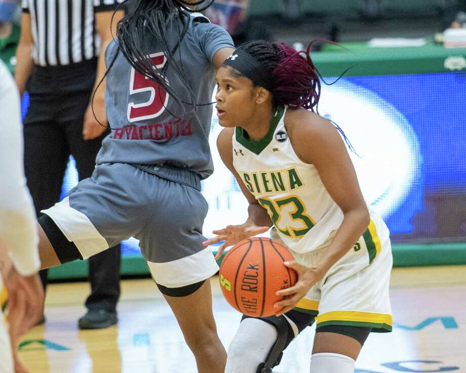 Siena College graduate student Isis Young takes a jumper after putting on a head fake in front of Rider University sophomore Maya Hyacienth during a Metro Atlantic Athletic Conference game against Rider University at the Alumni Recreation Center on the Siena campus in Loudonville, NY, on Saturday, Jan. 9, 2020 (Jim Franco/special to the Times Union.) Photo: James Franco / 40050505A