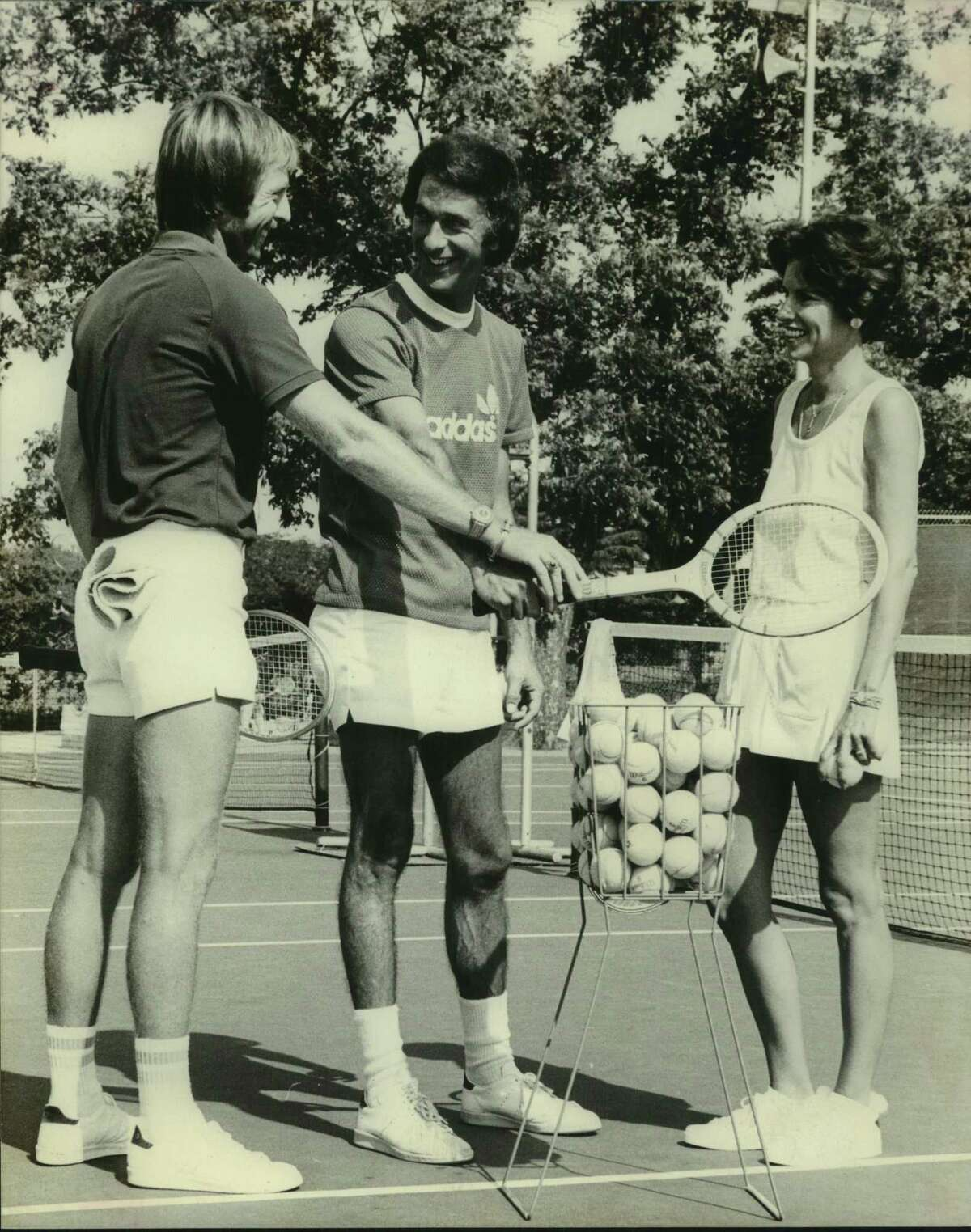 Paul Venema, center, chats with other tennis players during a celebrity tournament in this undated photo.