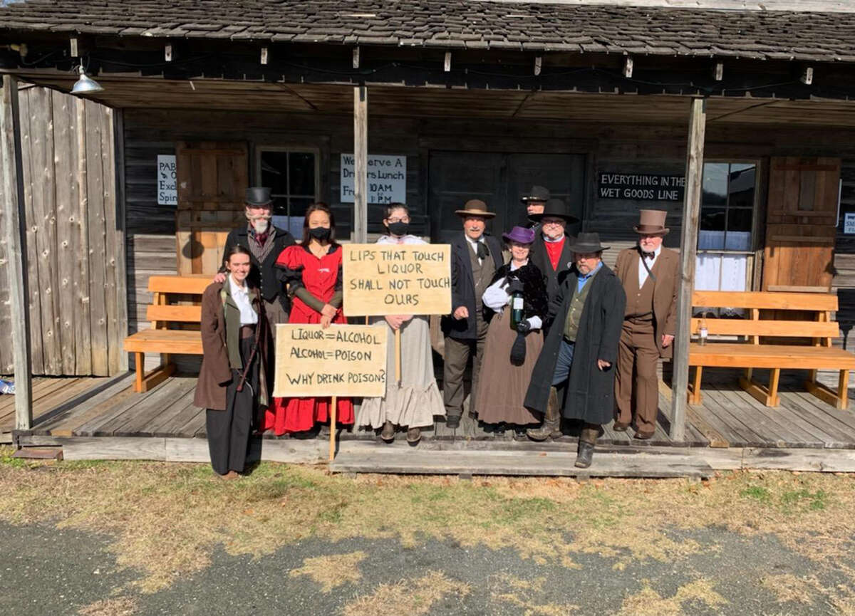 Historical reenactors took part in the Spindletop Gladys City Boomtown Museum's commemoration of the 120th anniversary of the Spindletop gusher on Saturday.