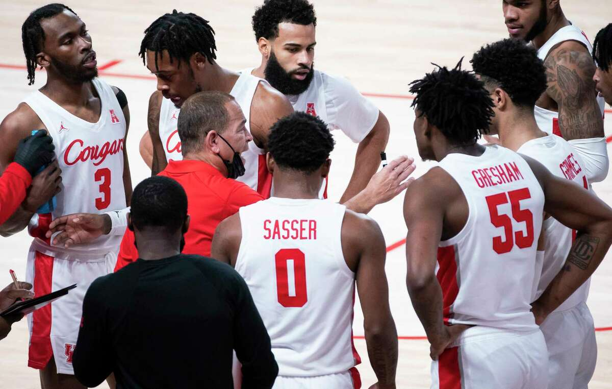 Cougars head coach Kelvin Sampson talks with his team during a timeout during the first half of a game between the University of Houston Cougars and the Tulane University Green Wave on Saturday, Jan. 9, 2021, at the Fertitta Center in Houston.