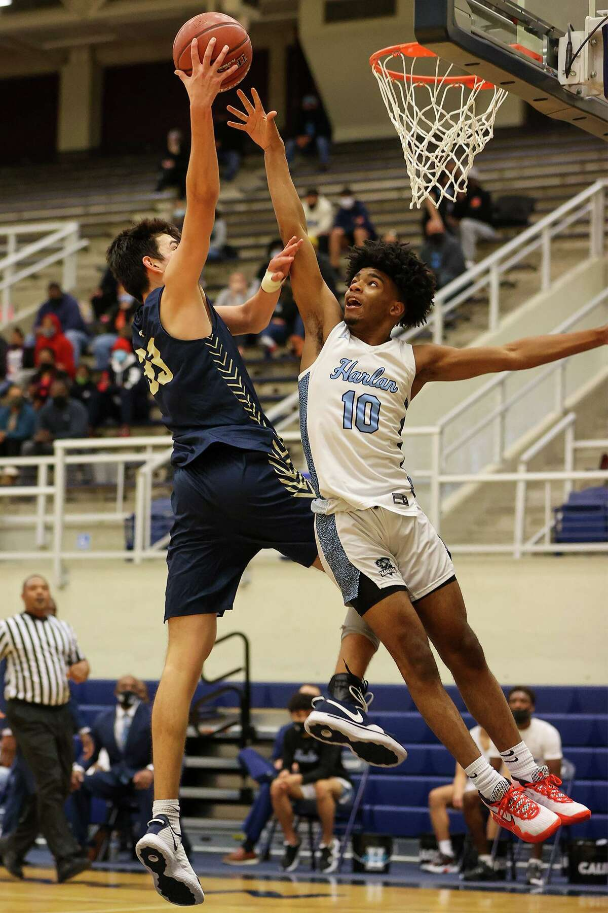 O'Connor's Josh Alcocer, left, drives to the basket as Harlan's Aashon Holmes defends during their District 29-6A boys basketball game at Paul Taylor Field House on Saturday, Jan. 9, 2021. O'Connor beat Harlan 59-50.