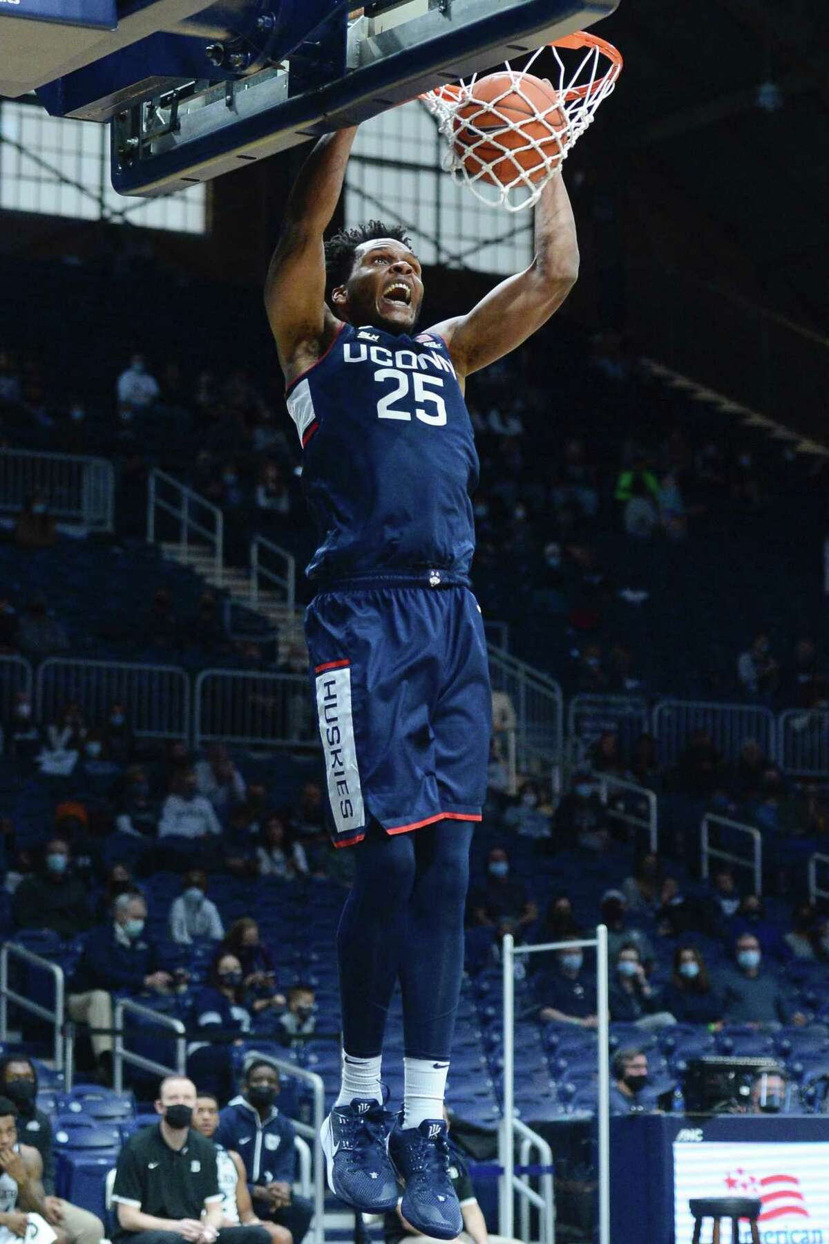UConn's Josh Carlton dunks against Butler on Saturday.