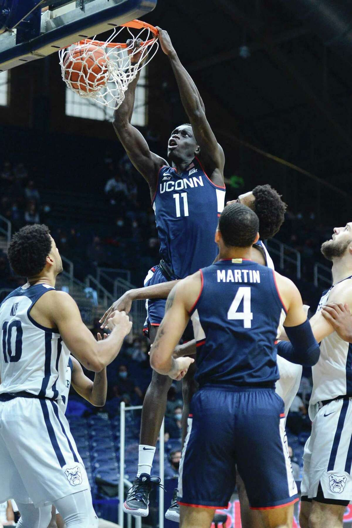 UConn's Akok Akok dunks during Saturday's game against Butler.
