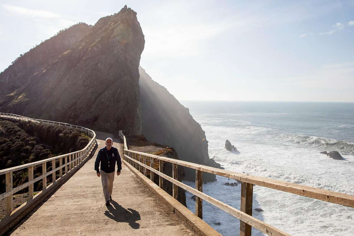 Dr. Padraig Duignan poses for a portrait while walking along a popular whale sighting location near Point Bonitas Lighthouse in Mill Valley, Calif. Thursday, January 7, 2021.