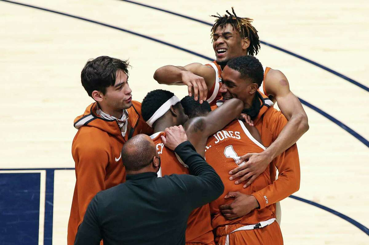 Texas players celebrate after defeating West Virginia on a last-second shot by Andrew Jones.