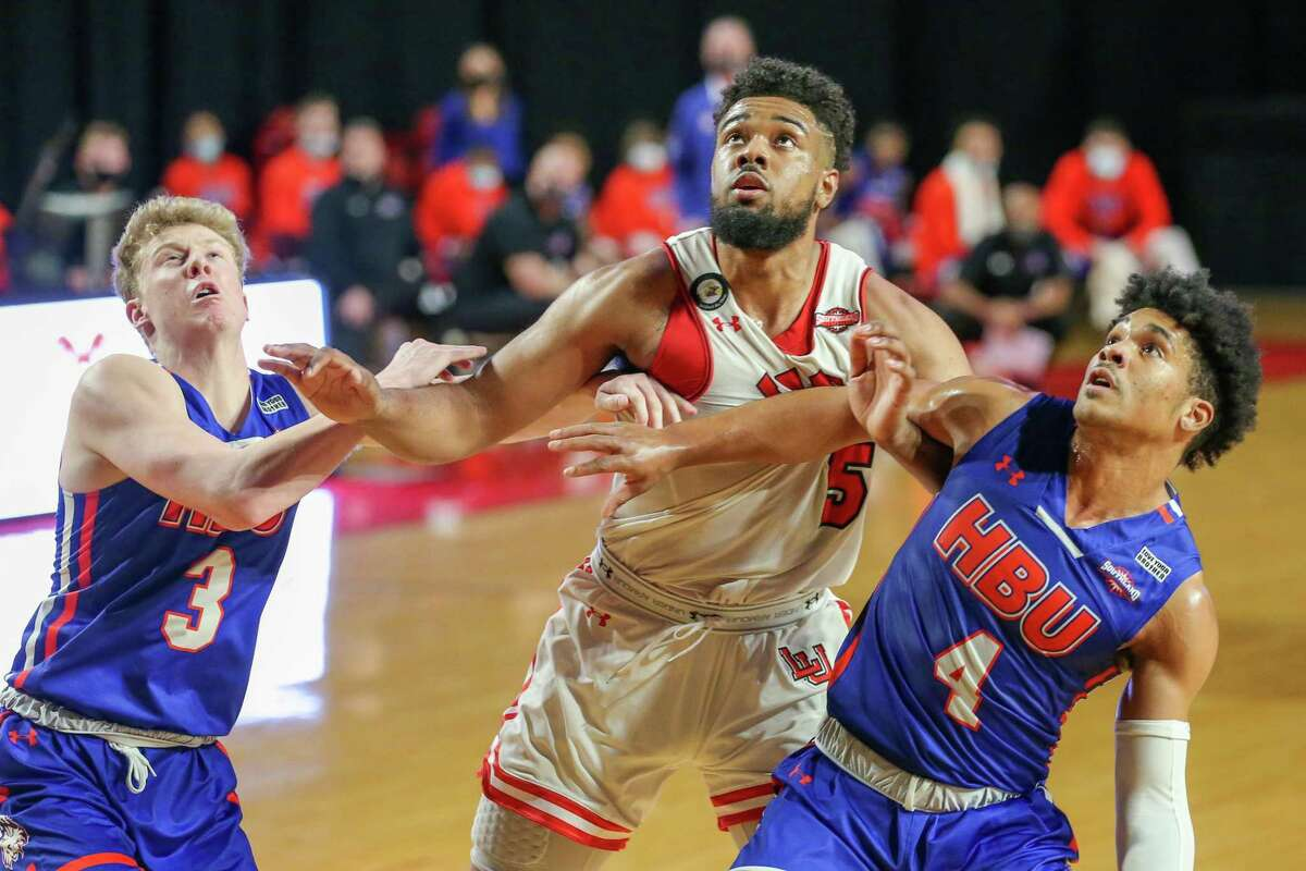 Senior forward Avery Sullivan battles for positioning with two Houston Baptist defenders during Lamar's win Saturday afternoon at the Montagne Center.