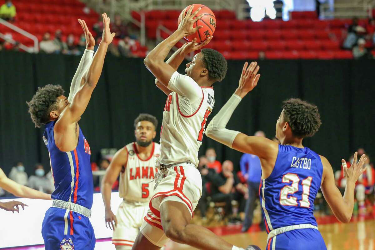 Lamar's Lincoln Smith adjusts mid-air as he shoots during the Cardinals home win over Houston Baptist on Saturday at the Montagne Center.