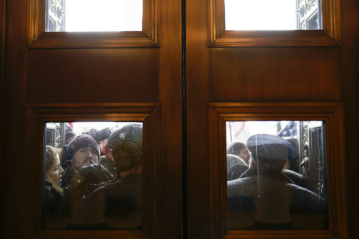 U.S. Capitol Police try to hold back protesters outside the east doors to the House side of the Capitol on Wednesday. Rep. Eric Swalwell, D-Dublin, was among the last lawmakers to leave the House floor.