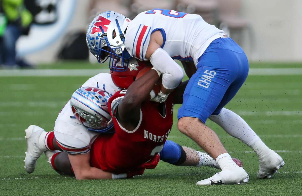 North Shore running back Shadrach Banks (2) is stopped short of the first down by Austin Westlake's Brady Lamme and Carter Barksdale (21) on fourth down during the fourth quarter of a Class 6A Division I semifinal playoff high school football game at Legacy Stadium Saturday, Jan. 9, 2021 in Katy, Texas. Westlake took over on downs and ran out the clock, advancing to the state title game with a 24-21 win.