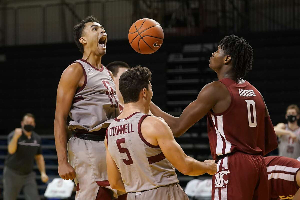 Stanford forward Oscar da Silva (left) celebrates with teammate Michael O'Connell after scoring and being fouled in front of Washington State center Efe Abogidi in the second half.