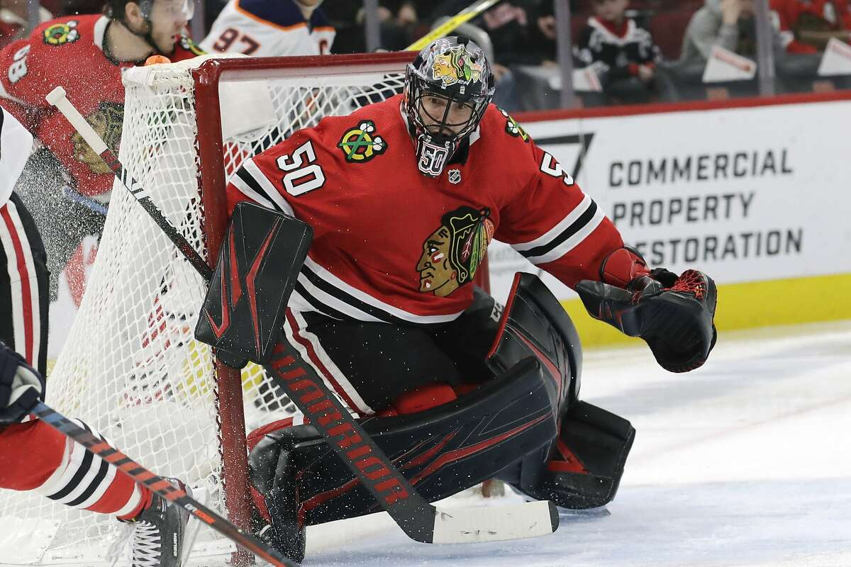 In this March 5, 2020, file photo, then-Chicago Blackhawks goalie Corey Crawford watches the puck during the second period of an NHL hockey game against Edmonton in Chicago. Crawford, who signed as a free agent a with the New Jersey Devils, has decided to retire.