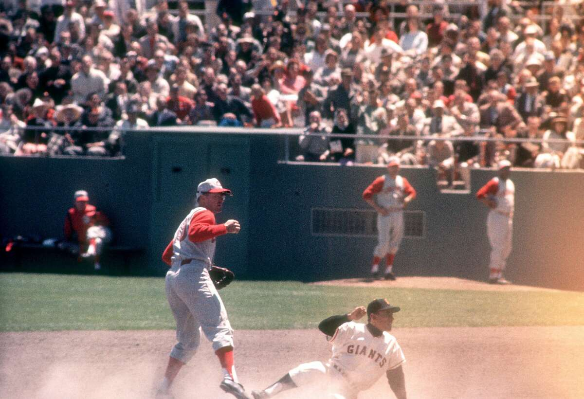 SAN FRANCISCO, CA - MAY 30: Eddie Kasko #10 of the Cincinnati Reds forces out Joey Amalfitano #14 of the San Francisco Giants during an MLB game on May 30, 1961 at Candlestick Park in San Francisco, California. (Photo by Hy Peskin/Getty Images) (Set Number: X7595)