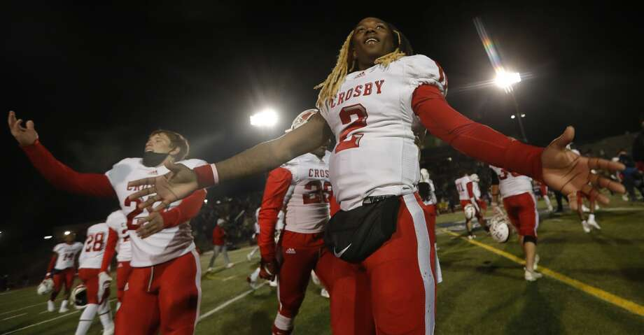 Crosby quarterback Deniquez Dunn (2) celebrates after defeating Liberty Hill 62-61 in overtime during a Class 5A Division II state semifinal high school football game at Merrill Green Stadium, Friday, Jan. 8, 2021, in Bryan. Photo: Jason Fochtman/Staff Photographer / 2021 © Houston Chronicle