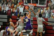 UAlbany's Chuck Champion goes to the basket against St. Joseph's on Saturday.