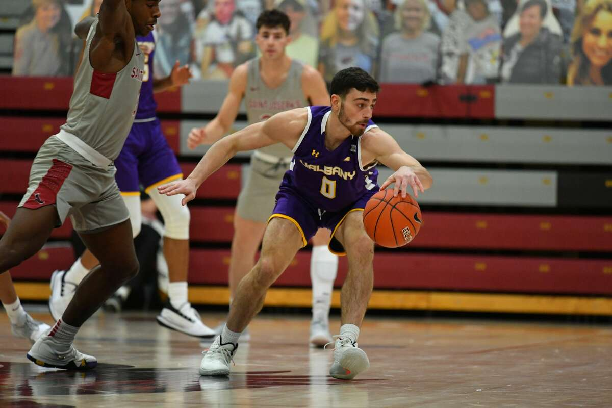 UAlbany's Antonio Rizzuto looks for room to dribble against St. Joseph's on Saturday. He had been named UAlbany's lone captain for this season.