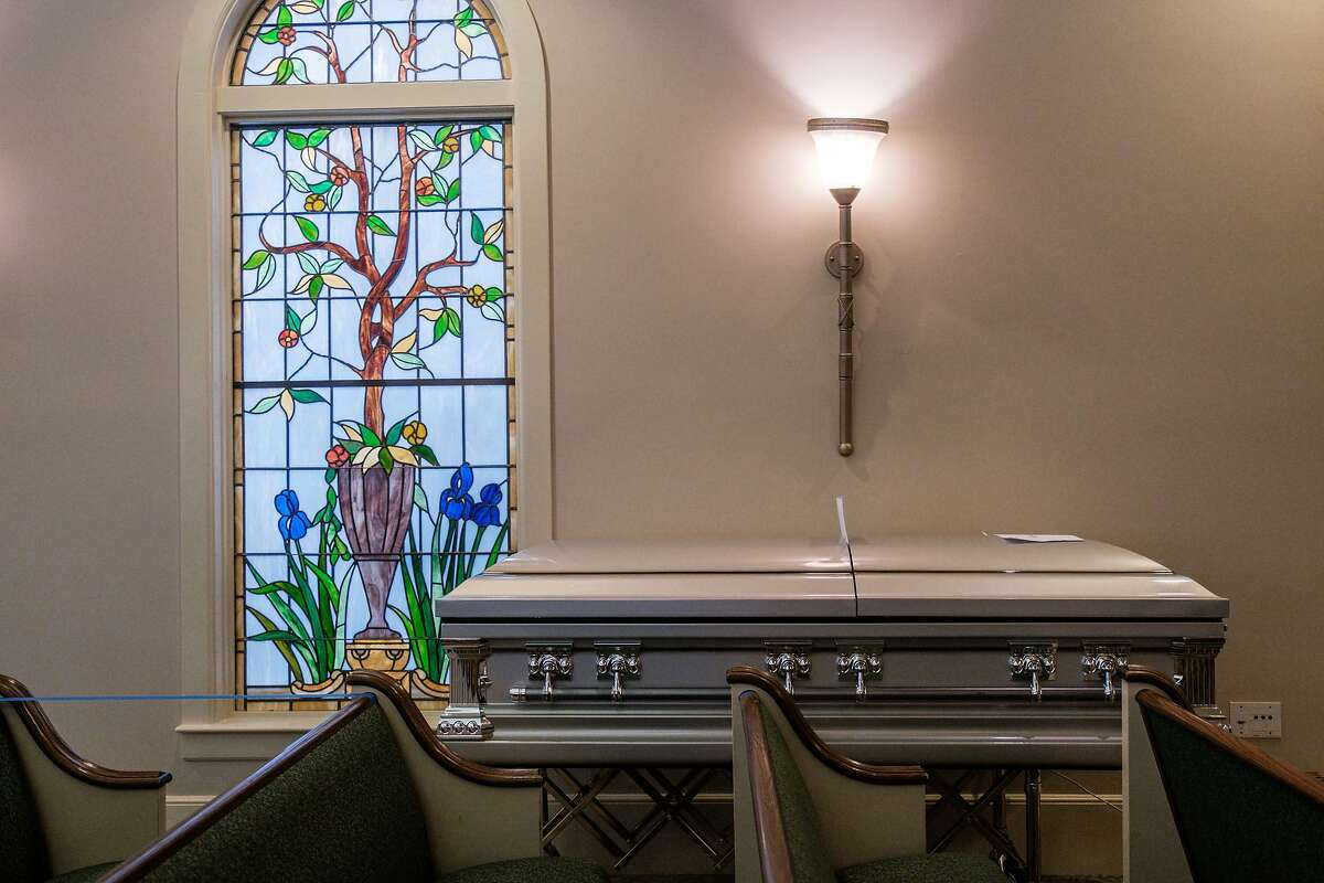 A casket in a chapel normally reserved for services at Cypress Lawn Memorial Park in Colma.