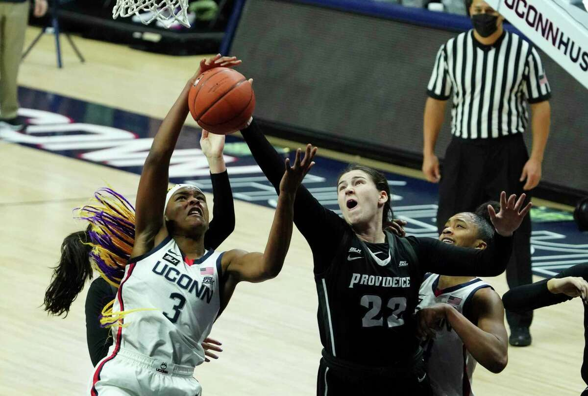 UConn forward Aaliyah Edwards (3) works for the rebound against Providence guard Olivia Orlando in the second half on Saturday.