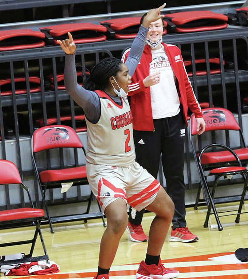SIUE's Prima Chellis and Allie Troeckler (back) react after Tori Handley's 3-pointer extended the Cougars' lead to 59-48 with 3:24 left in the fourth quarter Saturday afternoon at First Community Arena in Edwardsville. The Cougars defeated Murray State 64-57 to halt their Ohio Valley Conference losing streak at 18 in a row. SIUE, which is 4-4 and 1-2 in the OVC, is back home Monday afternoon to play Eastern Illinois. Photo: Greg Shashack / The Telegraph