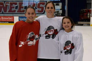 Emily, Jennifer and Caitlyn Speck don RPI red and white jerseys. Jennifer played defense for the Engineers in the early 2000s, following in the footsteps of her father, Hall of Famer Richard Scammell, class 1969. (Provided)