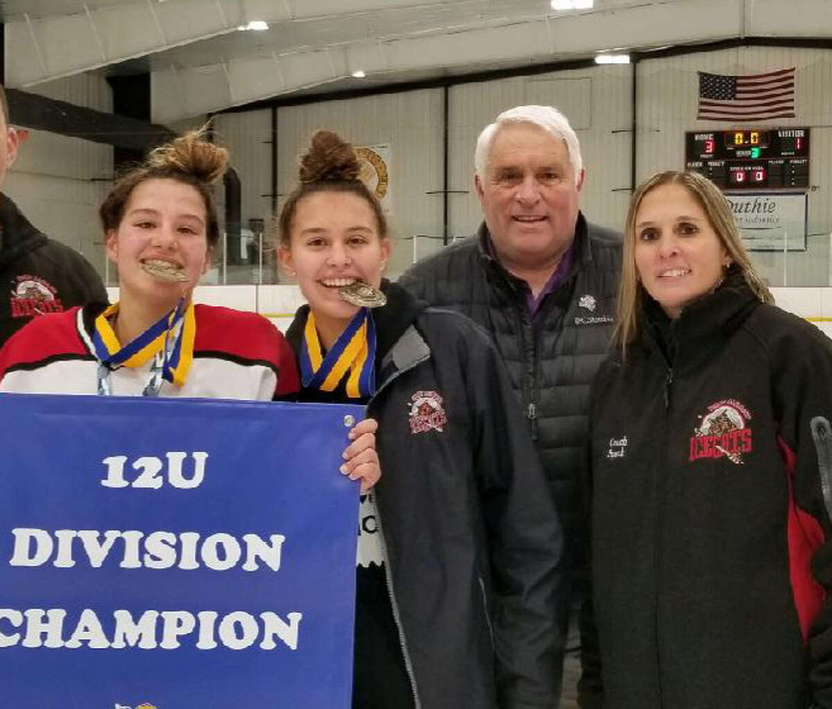 Caitlyn, Emily and Jennifer Speck with the girls' grandfather Richard Scammell, who is the founder and longtime coach of the Troy Albany Ice Cats girls hockey program. (Provided)