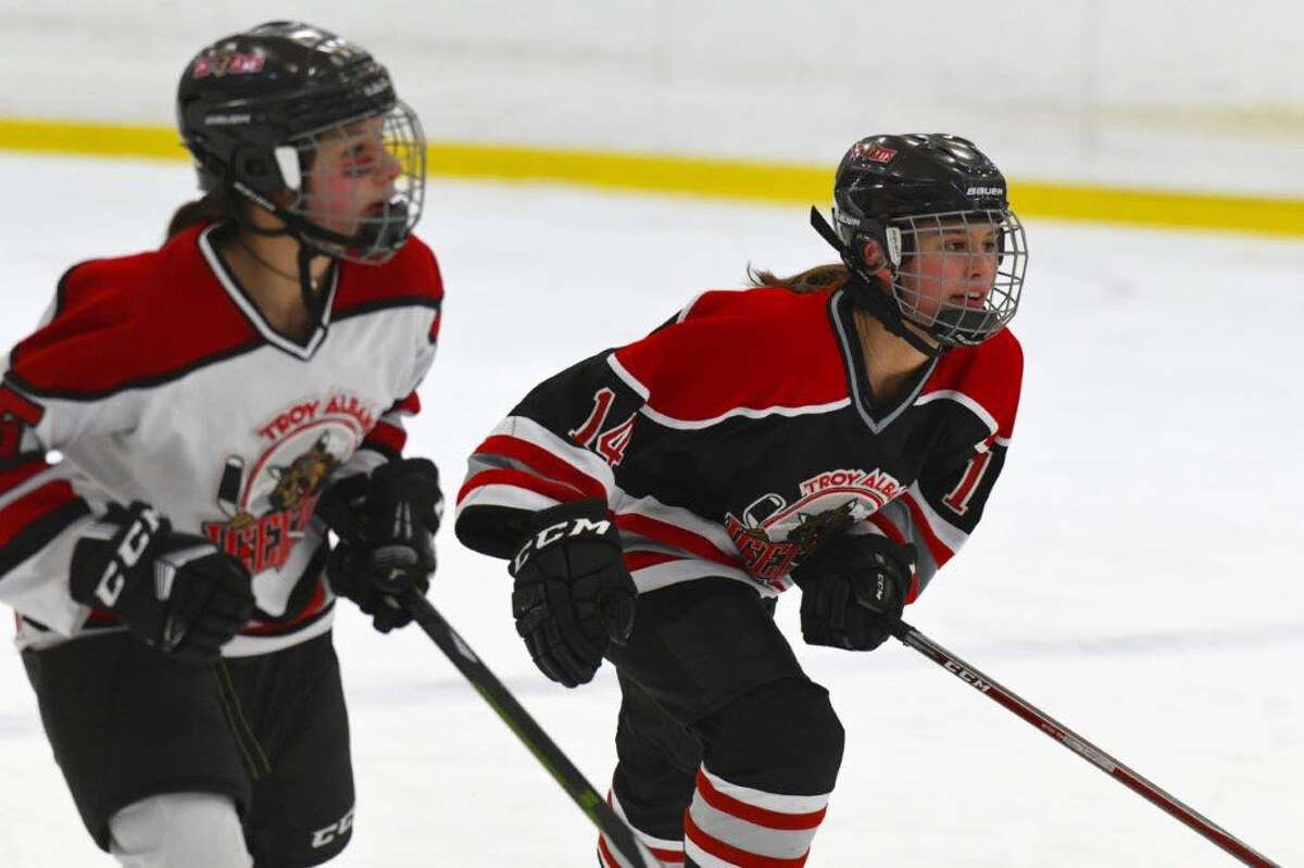The Speck sisters of Clifton Park, from left, Caitlyn and Emily, take the ice for the Troy Albany Ice Cats. (Provided)