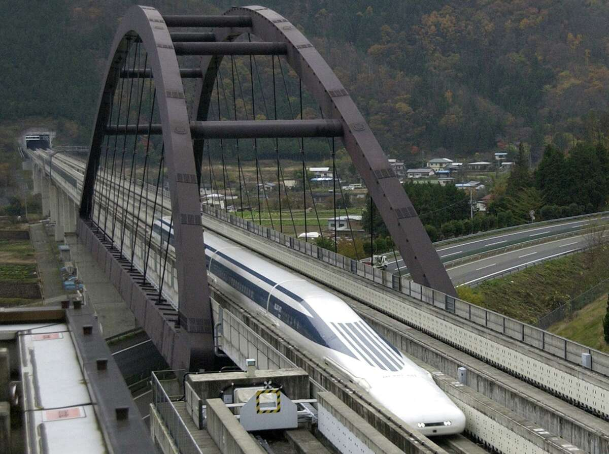 A test model MLX01-901 maglev train runs on the 18.4-kilometer (11.4-mile) test track in Tsuru, west of Tokyo, Thursday, Nov. 27, 2003. Reaching 500 kilometers (310 miles) per hour takes less than a minute and a half for Japan's maglev train, which derives its name from the way it uses an electromagnetic cushion instead of wheels for levitation and propulsion. Officials point to the high-tech showpiece as the future of mass-transit. But after four decades and 260 billion yen (US$ 2.4 billion) spent onresearch, the maglev has just one station, no ticket booths, and no clear future. (AP Photo/Chiaki Tsukumo)