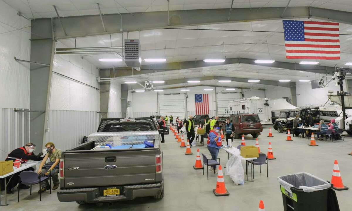 Teachers and others trying to use a state portal to sign up for the coronavirus vaccine reported confusion over the system after it launched Monday. In this photograph, people get vaccinated at a pilot drive-in vaccination pod administered by the Albany County sheriff's department on Sunday. (Paul Buckowski/Times Union)