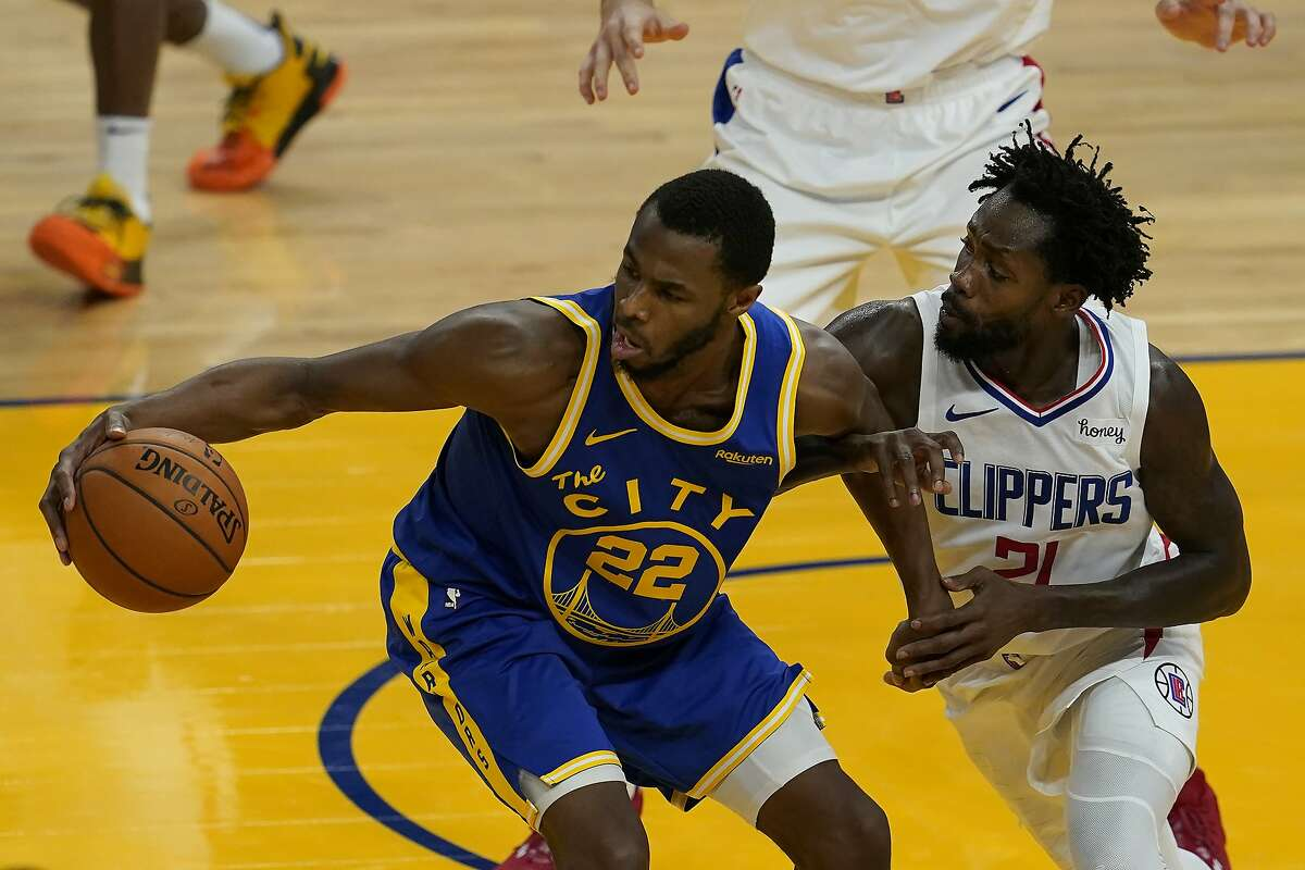 Golden State Warriors forward Andrew Wiggins (22) is defended by Los Angeles Clippers guard Patrick Beverley (21) during an NBA basketball game in San Francisco, Wednesday, Jan. 6, 2021. (AP Photo/Jeff Chiu)