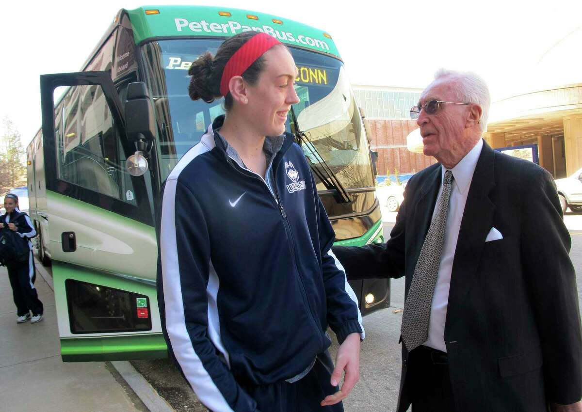 Former Connecticut men's basketball coach Dee Rowe, right, wishes forward Breanna Stewart luck Thursday, April 3, 2012 in Storrs, Conn., as she prepares to board the team bus to the airport for a flight to the Women's NCAA Final Four in Nashville. (AP Photo/Pat Eaton-Robb)