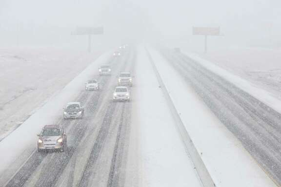 Vehicles driving in the snow on the southbound of Highway 6 Sunday, Jan. 10, 2021, in College Station.
