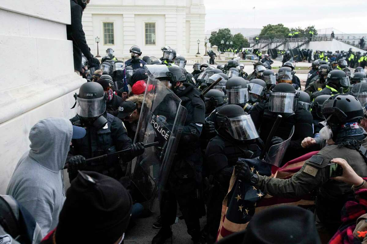 U.S. Capitol Police push back demonstrators who are trying to enter the U.S. Capitol on Wednesday, Jan. 6, 2021, in Washington.