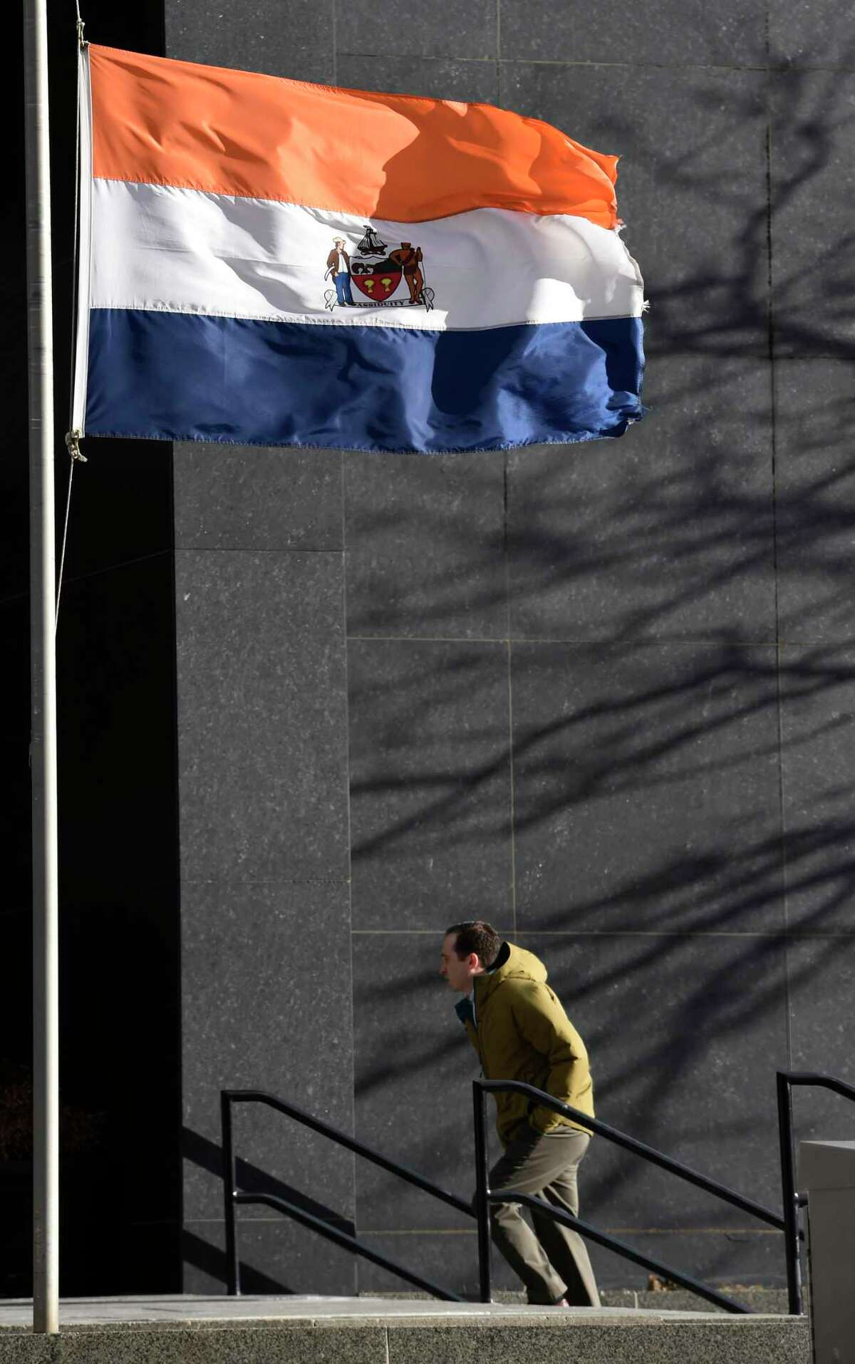 High winds keep the flag straight out in downtown Monday morning, Jan. 5, 2015, in Albany, N.Y. (Skip Dickstein/Times Union)