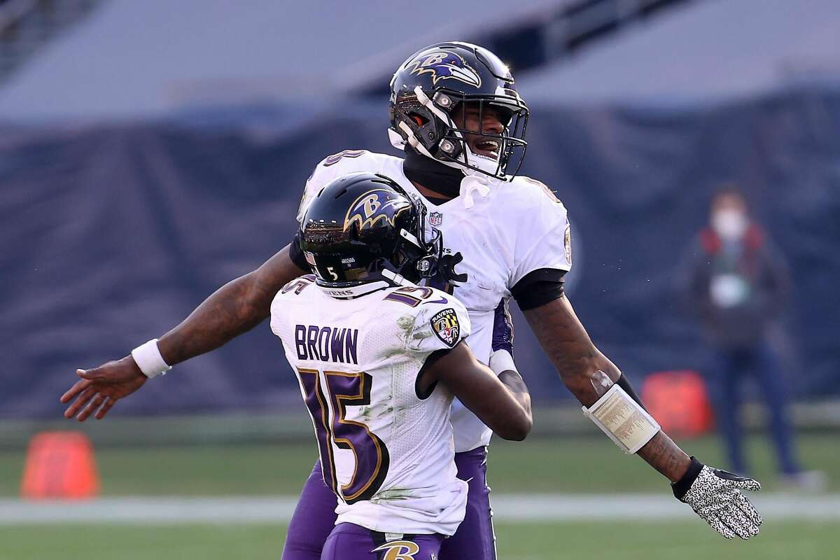 Quarterback Lamar Jackson and wide receiver Marquise Brown exult after the Baltimore Ravens' 20-13 wild-card playoff victory over the Tennessee Titans in Nashville.